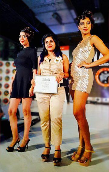 Elisha walking a ramp at Mumbai Fashion show with her models