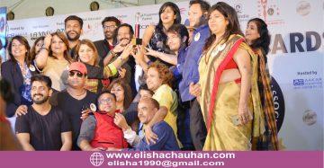 Elisha Chauhan lifted on stage for International Achievement Award