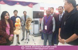 Elisha Chauhan showing hairstyles to Skill Development Minister Mr.Rajiv Pratap Rudy