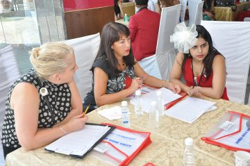 Elisha Chauhan working with Experts from UK