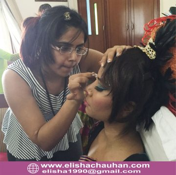 Elisha working on models(backstage) in Guwahati_India